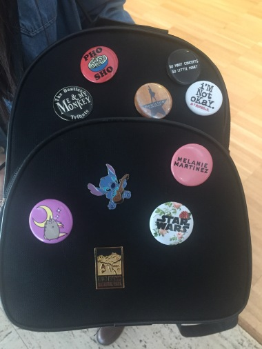 Lexi's pin collection on her backback